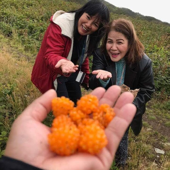 "Feyma loves these ""Salmon Berries"" that they pick in Alaska."